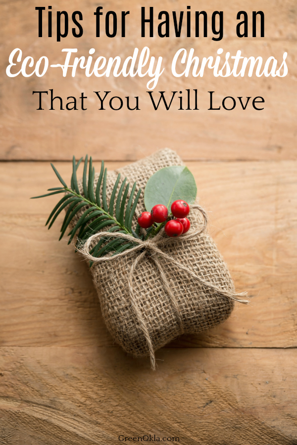 Natural holiday wrapped gift with holly berries