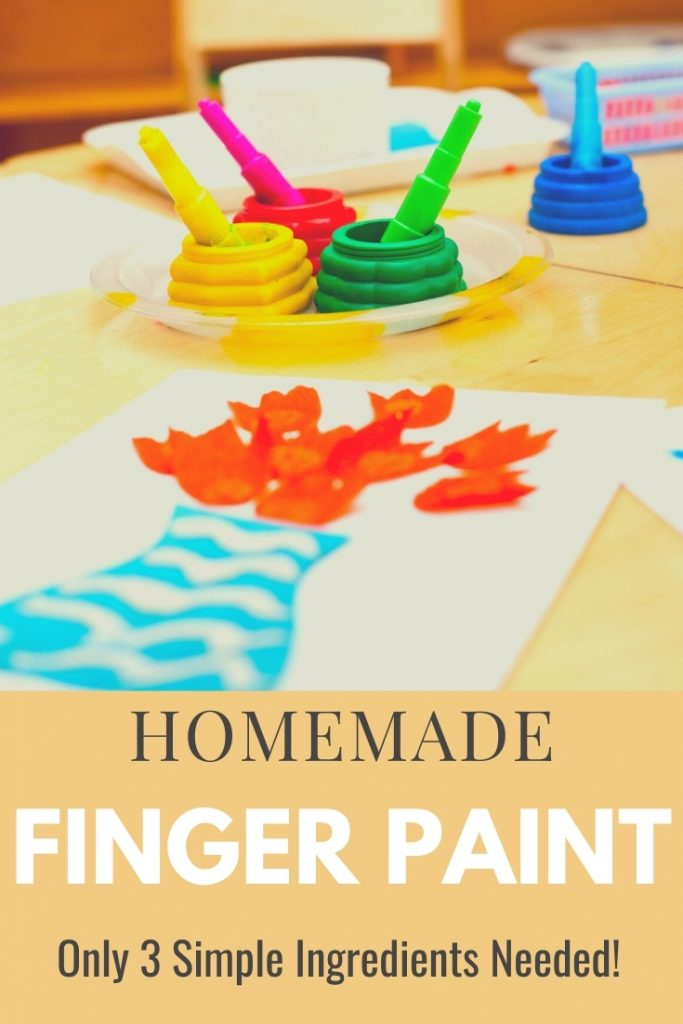 homemade finger paint on table with painting of flowers