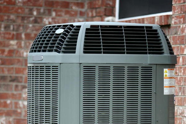 High efficiency air conditioner on brick wall background