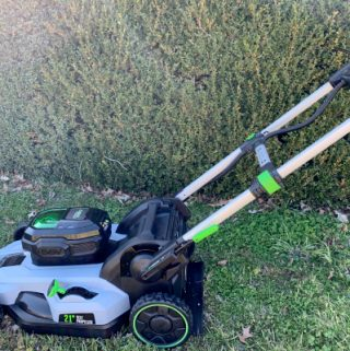 electric lawn mower in grass