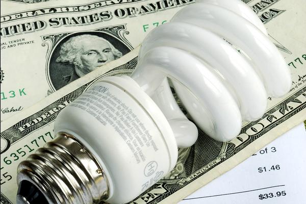 light bulb on money and bill