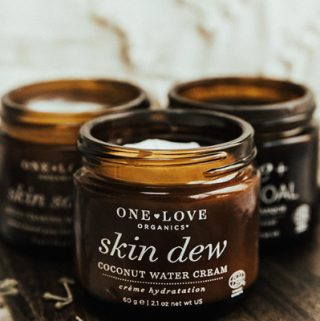bottles of One Love Organics skin care