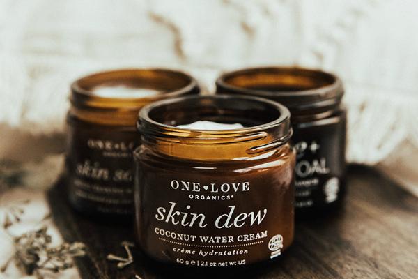 bottles of One Love Organics skin care