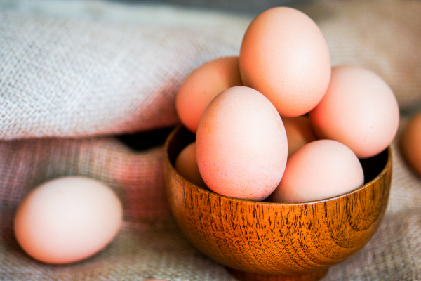 basket of eggs on table