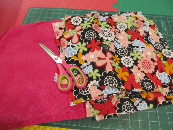 colorful fabric on sewing table with scissors