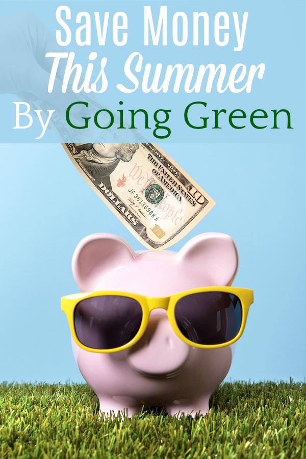 Hand putting a ten dollar bill into a pink piggy bank with sunglasses grass and blue sky
