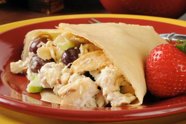 chicken salad with grapes and strawberries in a crepe