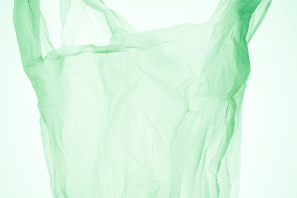 green plastic bag on green background
