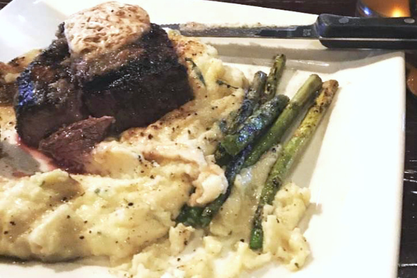 steak on mashed potatoes with asparagus