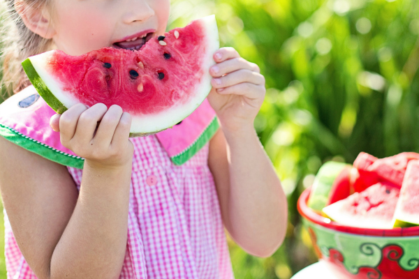 kid eating a watermelon