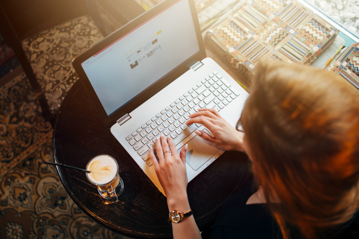 woman on computer with coffee