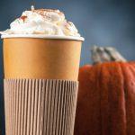 Pumpkin spice latte in a paper cup