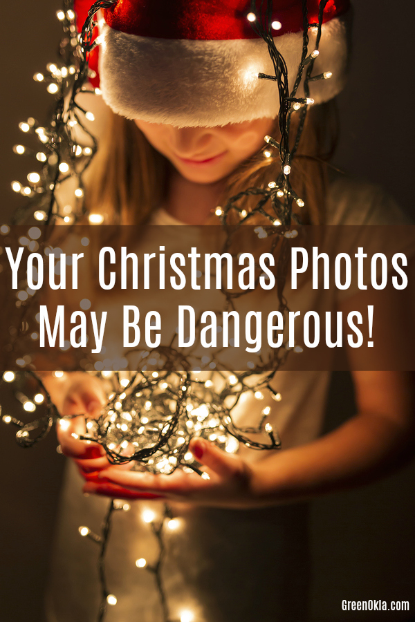 Child holding Christmas lights