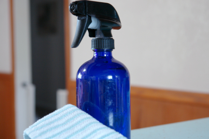 blue spray bottle and rag in kitchen
