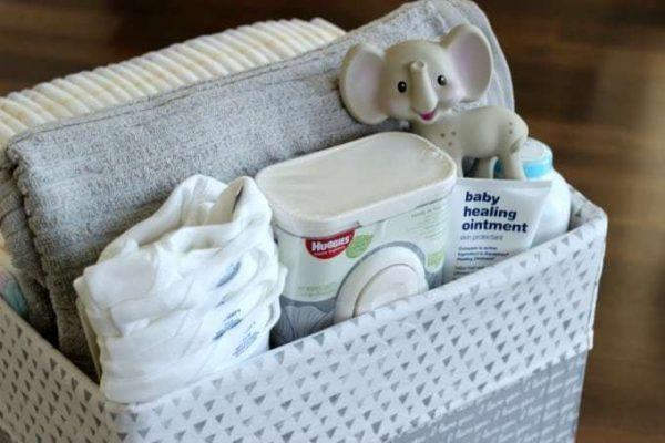 diaper box storage tote filled with baby supplies