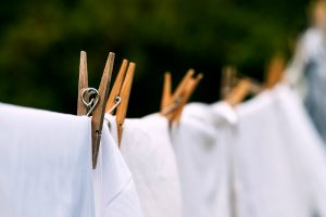 white clothes on clothesline with wooden clothespins