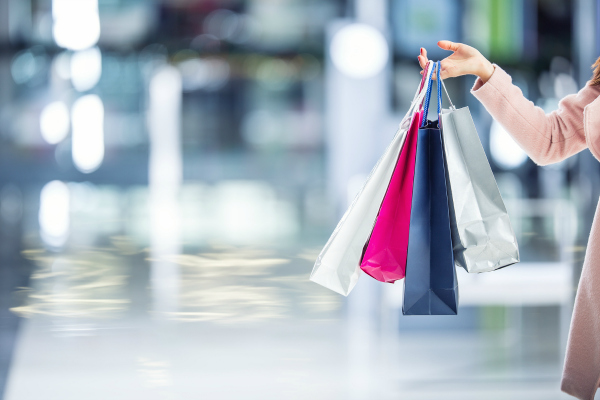 woman in shopping center with bags