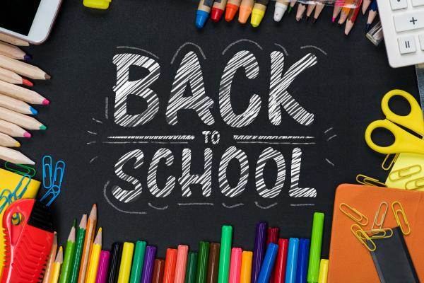back to school supplies on chalk board