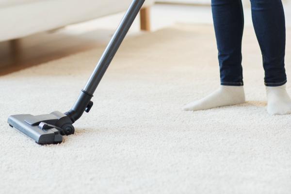 person vacuuming