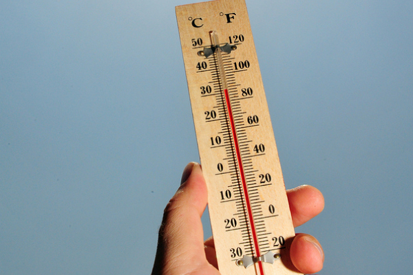 A thermometer shows high temperature during a heatwave.