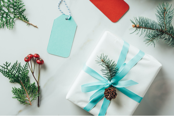 christmas gift boxes and gift tags on white table