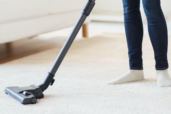 close-up of person vacuuming