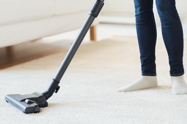 close-up of person vacuuming