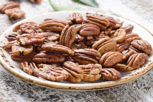 Pecan nuts on wooden table.